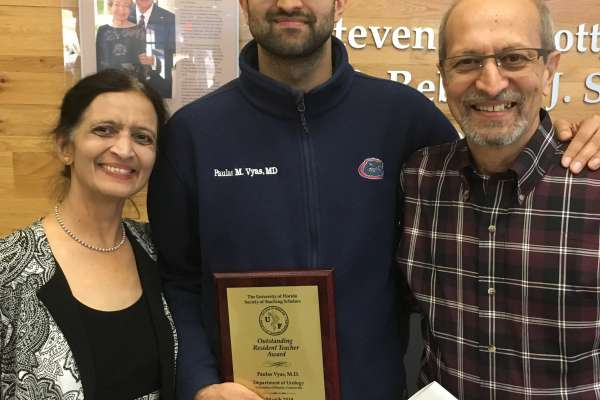 color photo of doctor Paulas Vyas and his parents
