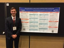 PICTURE OF DR RABLEY WITH HIS POSTER AT THE AUA