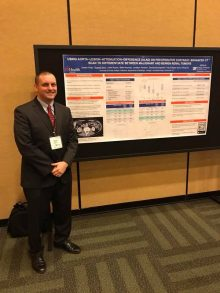 PICTURE OF DR. RUSS TERRY AT WITH HIS POSTER AT THE AUA
