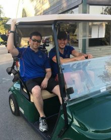 dr. bergamo and dr campbell in a golf cart