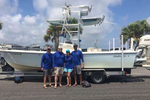 picture of dr su, dr terry, dr wardenburg and dr vyas in front of dr. su's boat