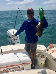 dr su holding a big fish