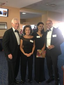 dr tom and leah stringer and dr kumar and his wife at the resident graduation banquet