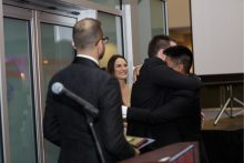 dr yeung hugging dr terry at the resident graduation banquet