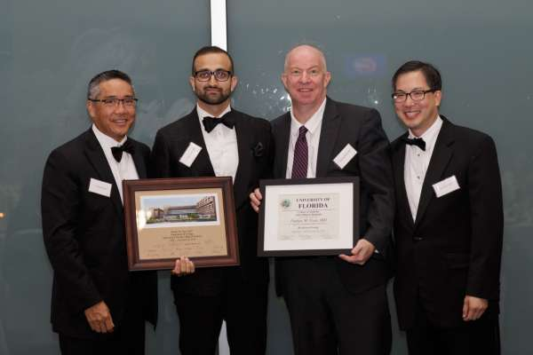 dr su, dr vyas, dr bird and dr moy at the resident graduation banquet