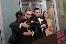 dr vyas hugging dr yeung at the resident graduation banquet