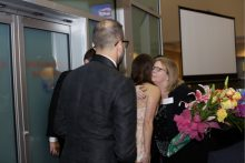 stephanie stenner being presented flowers at the resident graduation banquet
