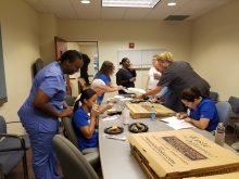 pictures of uf health urology med plaza clinic pizza party