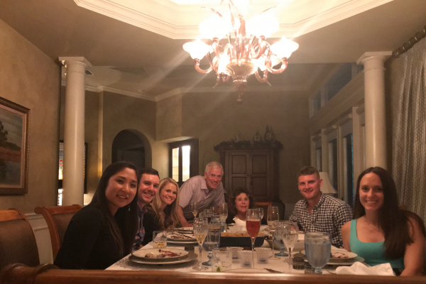 seated around the dining table in the stringers home are doctor han, doctor pavlinec and his wife allie, doctor tom stringer and his wife leah, and doctor noennig and his wife jennie.