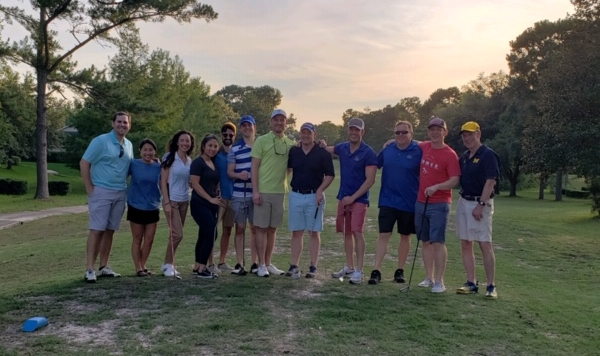picutre of faculty and residents on golf course prior to tournament