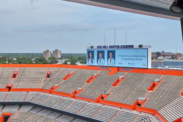 picture of jumbo tron with graduates pics on it