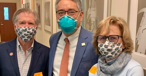 pictured left to right are mr obendorf, doctor li-ming su and mrs. obendorf. the are all wearing face masks.