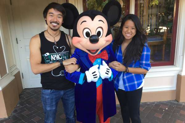 doctor Trisha Nguyen and her boyfriend with mickey mouse.