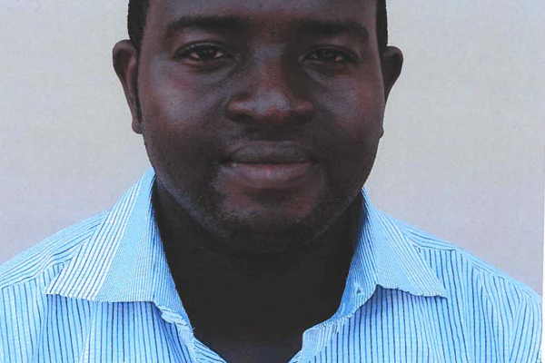 doctor tolani is pictured in a white shirt with blue stripes