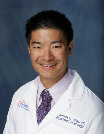 doctor larry yeung in his white doctors coat.