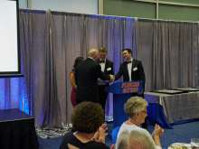 picture of dr bird receiving resident teacher of the year award