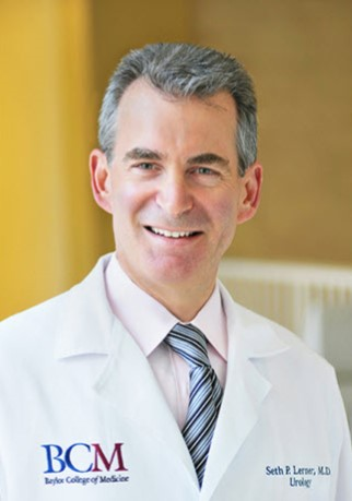 doctor seth lerner is the visiting professor for 2020 for uf urology. he is wearing a light colored shirt with a multi-striped tie. He is wearing his white doctors coat.