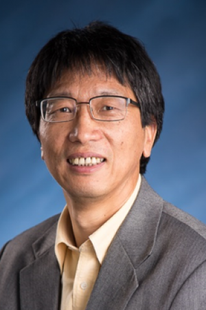 doctor liu is wearing a gray suit jacket with a pink collared shirt.
