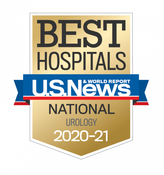 US NEW AND WORLD REPORT BEST HOSPITALS BADGE. IT IS A GOLD SHIELD WITH THE WORDS BEST HOSPITALS WRITTEN IN BLACK AT THE TOP. A BLUE BANNER WITH THE WORDS US NEWS AND WORLD REPORT IN WHITE. BELOW THE BLUE BANNER ARE THE WORDS NATIONAL WITH UROLOGY ON THE NEXT LINE. THE DATE 2020 - 21 IS AT THE BOTTOM IN WHITE.