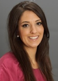 PROFESSIONAL PHOTO OF DOCTOR TARA MORGAN.  SHE IS WEARING A RED TOP.  SHE HAS LONG DARK HAIR.