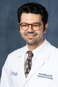 A PROFESSIONAL PHOTO OF DOCTOR MICHAEL MASSARI.  HE IS WEARING A WHITE DOCTORS COAT WITH A WHITE COLLARED SHIRT AND A MULTIPLE COLORED TIE.