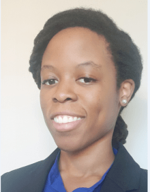 professional photo of doctor ibilibor. she has dark hair and is wearing blue shirt and black jacket.