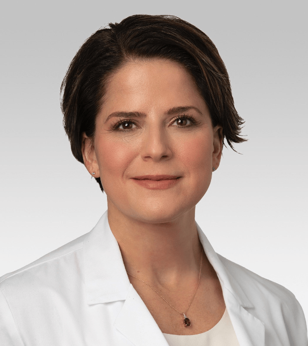 headshot of doctor amy krambeck. she is wearing a white doctors coat with a white blouse.