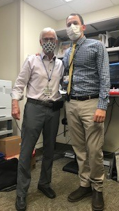 PICTURE OF DOCTORS STRINGER AND ASHOURI. THE ARE WEARING CASUAL PANTS, SHIRTS AND TIES.