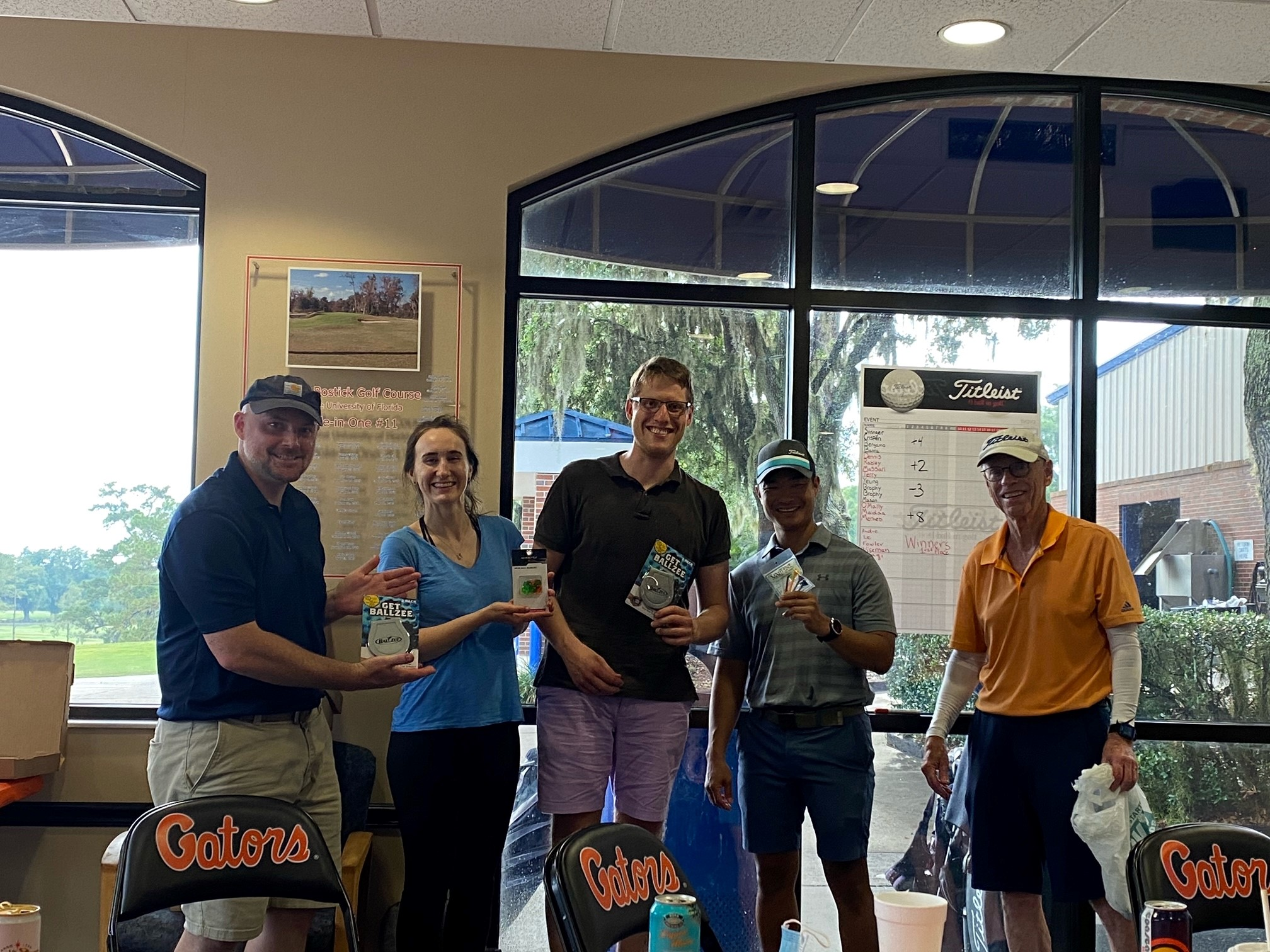 a group picture of doctor mason, whitney brophy, doctor carl brophy, doctor yeung and doctor stringer.  all are wearing casual clothes.  they had just finished a golf tournament.